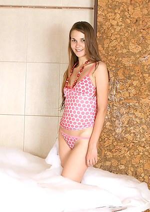 Gorgeous brunette babe Madison having fun soaking her body in a warm bubble bath