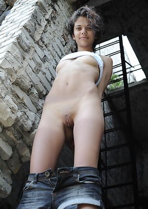 Extra hot fresh girlfriend with super tiny breasts and grandiose blue eyes enjoy the body flashing between old ruins.