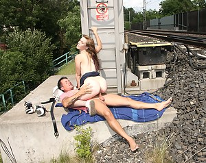 A bored couple waiting for a train starts fucking publicly