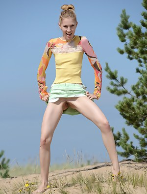 The hot sun burns her pale skin as she shows of her gorgeous form in some hot poses, while being naked and naughty.