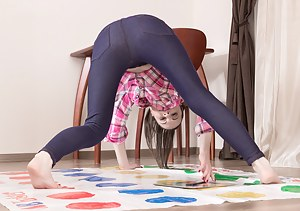 Whitney wears jeans and loves playing Twister. She strips and shows off her white lingerie and is fetching. Nakedness ensues as she is naked playing and spreads her hairy pussy all over the game for fun.