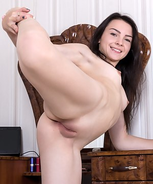 Flexible brunette with perky tits gets naughty with herself