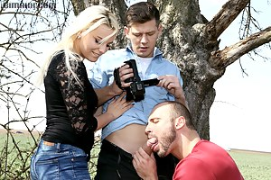 Blonde cutie sharing a big cock with a bisexual guy outdoors