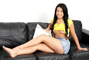 Kelly Diamond fingers her very tight pussy on the sofa.