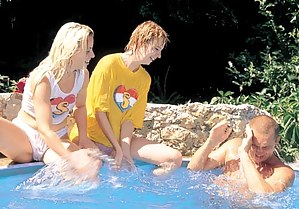 Two teenage girls having fun with dick in a swimmingpool