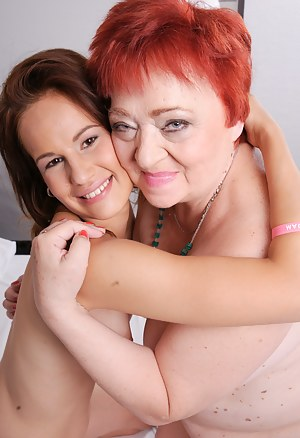 Two horny old and young lesbians make out on the bed