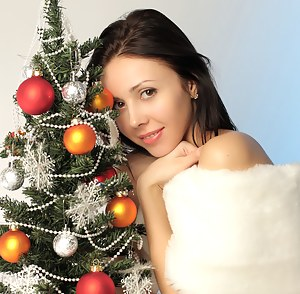 Admirable teen beauty gets nude by the Christmas tree and teases you with her perfect pussy.