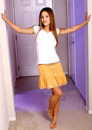 Andie lets her naughty feelings run wild on hallway nude and flirting